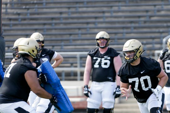 Purdue offensive lineman Will Bramel (70) runs through a drill during practice, Thursday, Aug. 1, 2019 at Ross-Ade Stadium in West Lafayette.