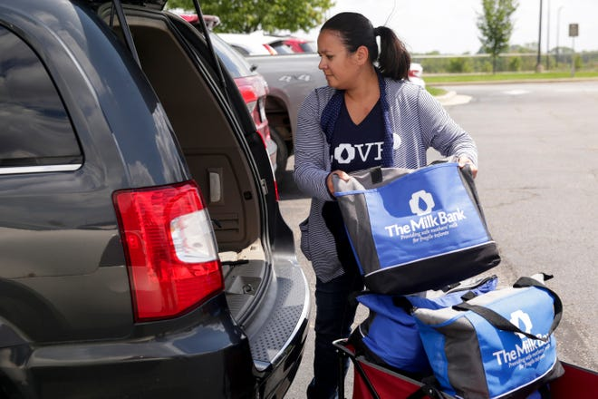 Jami Marvin, the production director at The Milk Bank, loads her van with donated breast milk after a breast milk drive at IU Arnett Hospital, Thursday, Aug. 1, 2019 in Lafayette.