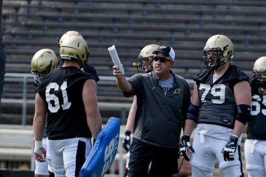 Purdue offensive assistant coach Dale Williams runs the line through drills during practice, Thursday, Aug. 1, 2019 at Ross-Ade Stadium in West Lafayette.