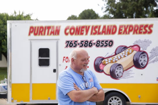 Gary Dowell stands in front of the Puritan Coney Island Express, Thursday, Aug. 1, 2019 in Lafayette.