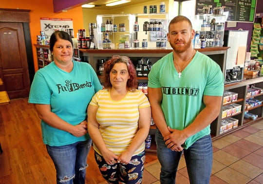 From left to right: Fit Blendz corporate manager Heather LeJeune, Mountain Pure owner Heather Carter, and former Baton Rouge store manager Hunter Head in front of a display selling Mountain Pure's CBD products at the Fit Blendz store on Airline Highway in Baton Rouge.