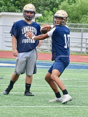 Lancaster junior quarterback Titan Johnson prepares to throw a pass during practice on Thursday at Fulton Field.