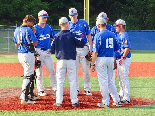 Lancaster Post 11 coach Dana Rowland talks with starting pitcher James Troup during the Ohio American Legion State Tournament on Wednesday at Beavers Field.