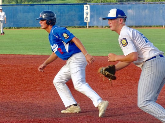 Lancaster Post 11's Zane Mirgon leads off first base after hitting a single during Wednesday's Ohio American Legion State Tournament.
