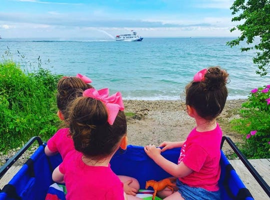 "The Buursma triplets enjoy a family adventure on Mackinac Island. Their adventures are the subject of children's book ""Triple the Fun on Mackinac Island"""