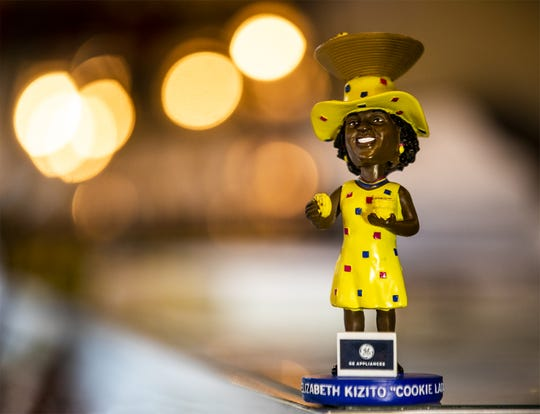 "Elizabeth Kizito's ""Cookie Lady"" bobblehead sits on the front counter at Kizito Cookies on Bardstown Rd. Aug. 1, 2019"