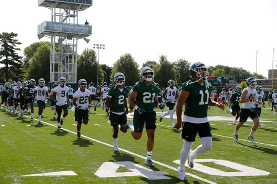 Michigan State players run a drill during the first practice of the season, Thursday, Aug. 1, 2019, in East Lansing, Mich.