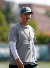 Michigan State offensive coordinator Brad Salem is shown during the first practice of the season, Thursday, Aug. 1, 2019, in East Lansing, Mich.