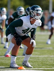 Michigan State's Kenny Willekes runs a drill during the first practice of the season, Thursday, Aug. 1, 2019, in East Lansing, Mich.