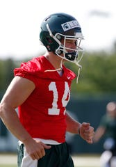 Michigan State quarterback Brian Lewerke warms up during the first practice of the season, Thursday, Aug. 1, 2019, in East Lansing, Mich.