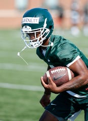 Michigan State's Julian Barnett runs a drill during the first practice of the season, Thursday, Aug. 1, 2019, in East Lansing, Mich.