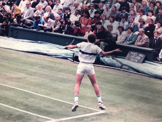 Bernie Fernandez captures tennis great John McEnroe hitting a backhand at Wimbledon. McEnroe won two Wimbledon titles during the years Fernandez shot the tournament for his Air Force base newspaper.