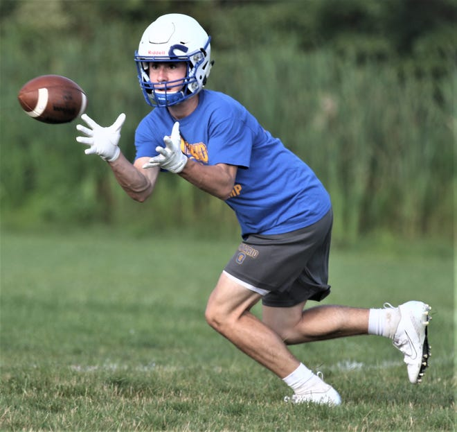 Ontario's Kolten Kurtz catches a pass during the first day of high school football practice on Thursday morning.