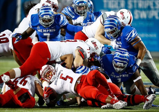 The Memphis defense brings down South Alabama running back Tra Minter (bottom) during action on  Saturday.  Mark Weber, The Commercial Appeal The Memphis defense brings down South Alabama running back Tra Minter (bottom) during action in Memphis, Tenn., Saturday, September 22, 2018.