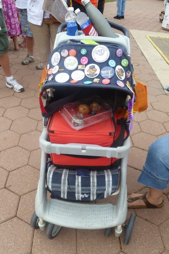 The Bienieks use a stroller, which James has long grown out of, to carry their stuff when they're at State Fair.