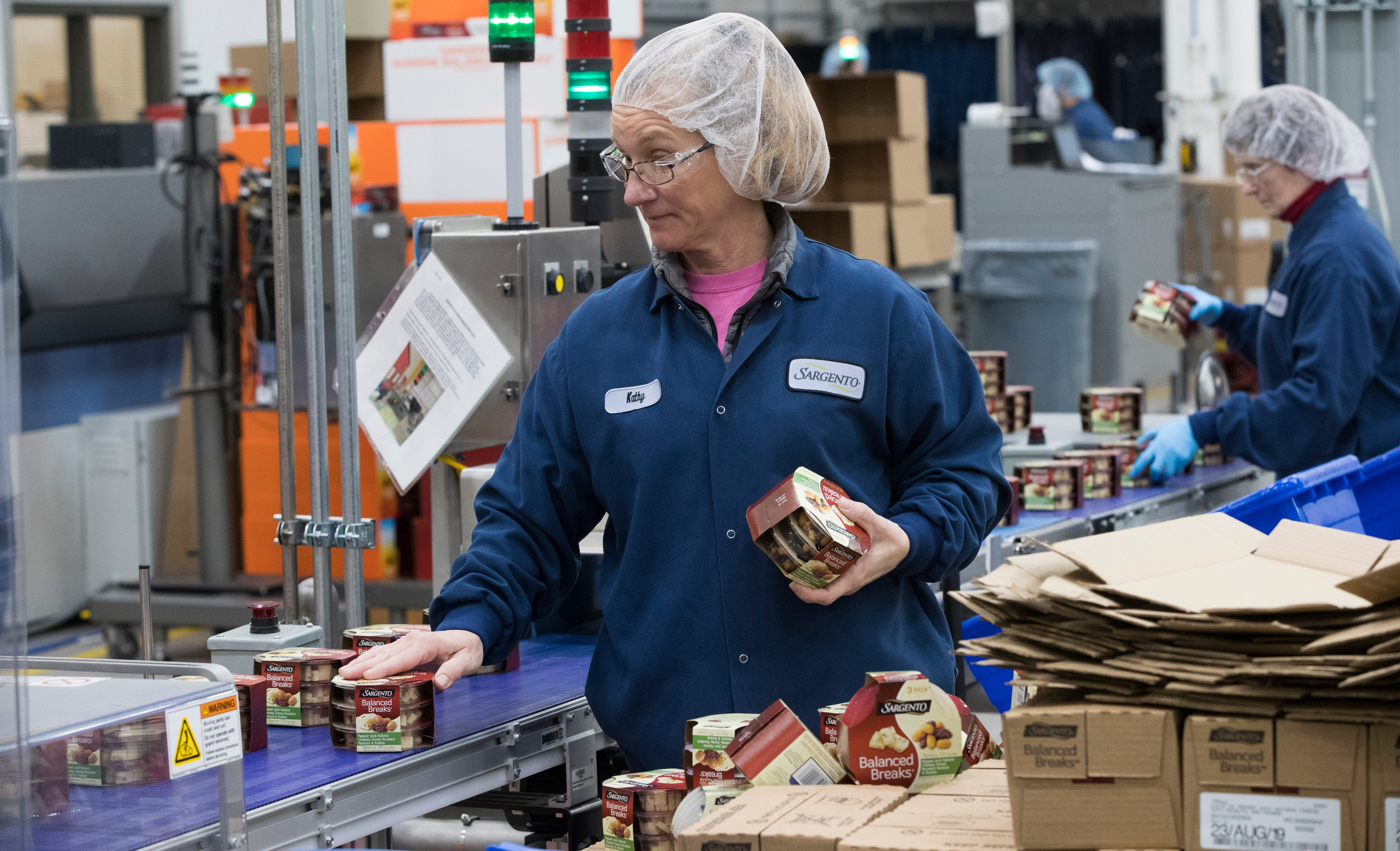 Kathy Griffey works on a line packaging Balanced Breaks snacks at Sargento Foods Inc. in Hilbert. The company employs about 2,300 people in Wisconsin. Sargento was the first company to sell packaged shredded cheese and the first to develop zippered packaging for its cheeses.