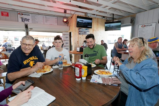 The Bienieks eat breakfast at Major Goolsby's at the Wisconsin State Fair in West Allis on Thursday, Aug. 1, 2019. Stacy (far right), Aaron Bieniek (second right) and their teenage son, James, 15, all from Hales Corners, have gone to the fair every day, every year for at least the past 15 years. They were with Stacy's father, Tom Kasprzak (far left) of West Allis.