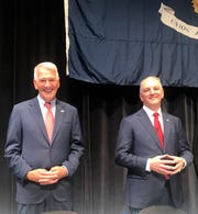 Republican Congressman Ralph Abraham and Democratic Gov. John Bel Edwards prepare to address a Louisiana Municipal Association audience Aug. 1, 2019, in Monroe. Abraham is challenging Edwards in the Oct. 12 governor's election.