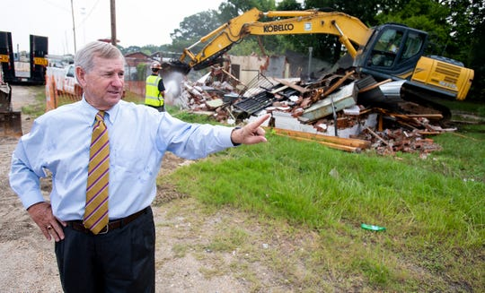 An abandoned building is demolished on Mobile Highway in Montgomery, Ala., on Thursday August 1, 2019. The building was the 435th and final destruction of abandoned building in the current plan. Mayor Todd Strange announced the next round of building demolitions at the destruction of the building.