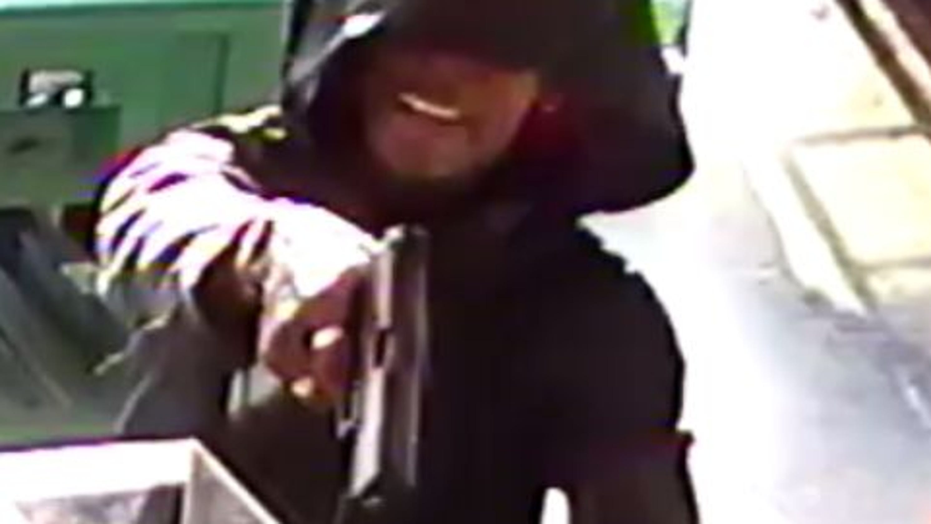 Police hunt for gun-toting man who robbed Troy Hwy  gas station