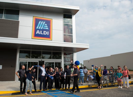 A ribbon is cut during the opening of the new ALDI grocery store in Montgomery, Ala., on Thursday, Aug. 1, 2019.