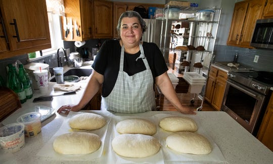 Yuliya Childers bakes bread for her business Wild Yeast Kitchen at her home in Prattville, Ala., on Thursday August 1, 2019.