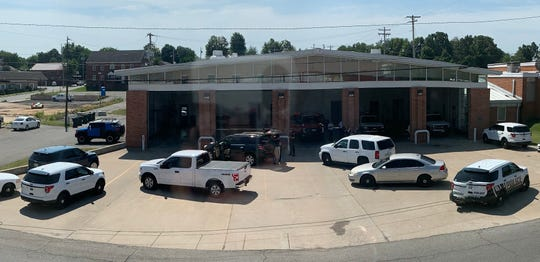 The scene where a shoplifter chase, involving spike strips, ended at the Dickson Fire Department on Thursday.
