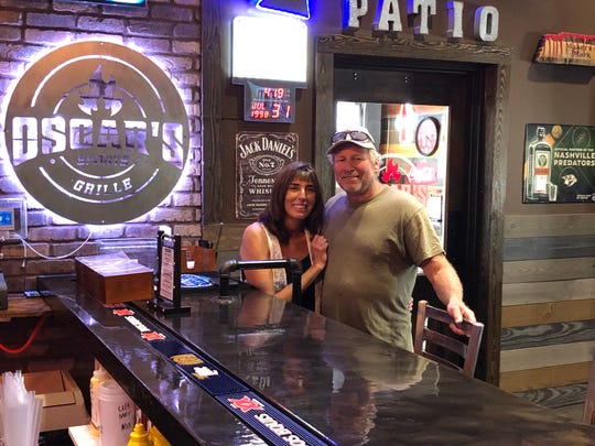 Sherri and Barry Smith are pictured at the bar of Oscar's Sports Grille in Gallatin.