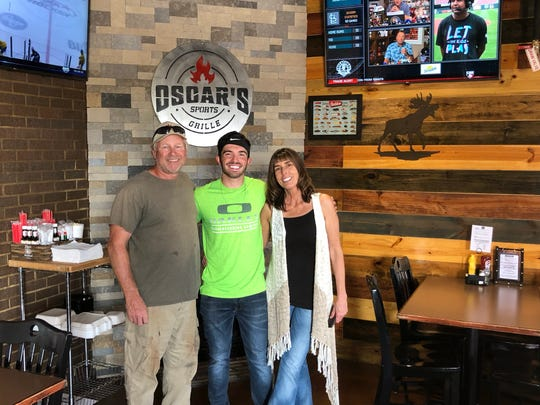Sherri and Barry Smith are pictured with their son, Kyle, who is a manager at Oscar's Sports Grille in Gallatin.