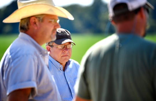 Jai Templeton, the ag commissioner under former Gov. Bill Haslam, listens as Brad Hunt and Alex Forsbach talk about the difficulties of maintaining their farm with ongoing tariffs against China on Wednesday, July 31, 2019, in Nashville, Tenn. Templeton is critical of Trump's farm bailout efforts. Templeton grows soybeans, which have been hard hit by the trade war with China.