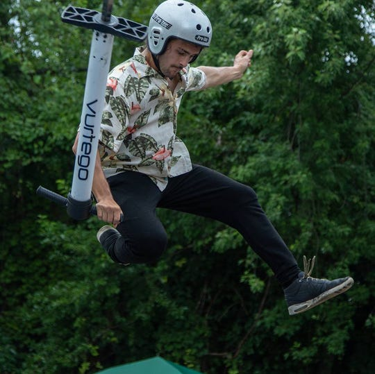 Extreme pogo world champion Dalton Smith of Franklin pulls off stunts in midair. He and his team, the XPogo Stunt Team, will perform each day at the Williamson County Fair starting Friday.