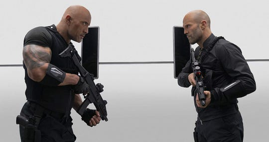 "Dwayne Johnson (left) and Jason Statham in ""Fast & Furious Presents: Hobbs & Shaw."" (Daniel Smith/Universal Pictures/TNS)"