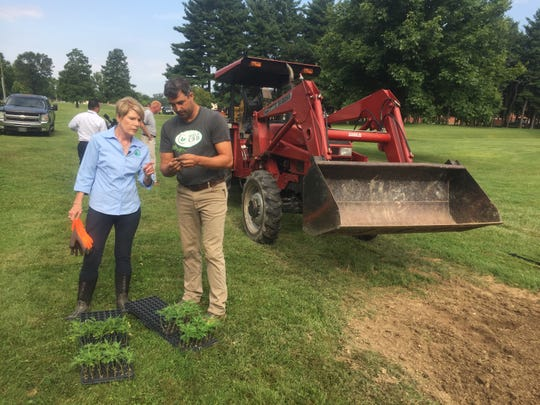 Dorothy Pelanda, Ohio Department of Agriculture director, discusses plant growth rates with Acela CBD's Ashley King on Aug. 1.