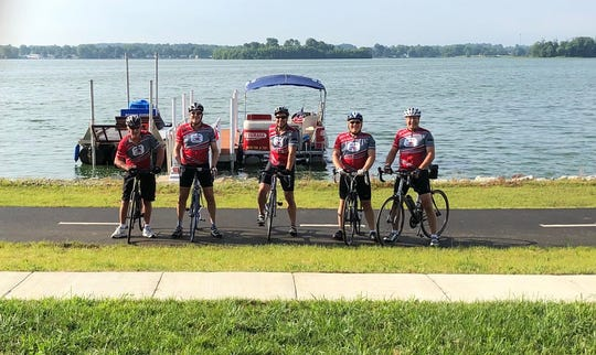 Cyclists pose for a photo as they prepare for the upcoming fundraiser Tour de Buckeye Lake on August 24.