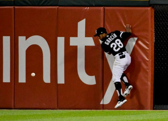 Chicago White Sox center fielder Leury Garcia tries to make a play on a ball hit for a double by New York Mets' Todd Frazier during the fifth inning of a game Wednesday, July 31, 2019, in Chicago.