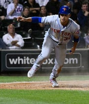 New York Mets' Michael Conforto stands up after scoring against the Chicago White Sox during the sixth inning of a  game Wednesday, July 31, 2019, in Chicago.