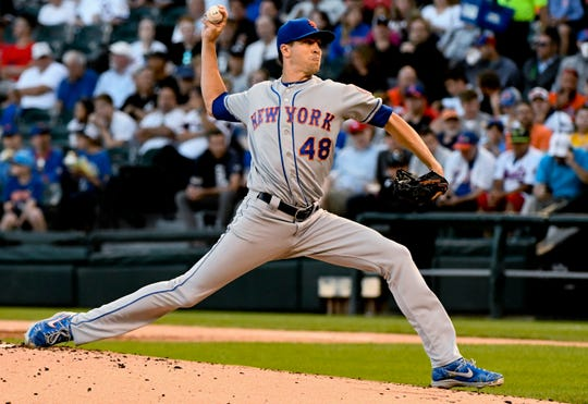 New York Mets starting pitcher Jacob deGrom delivers during the first inning of the team's game against the Chicago White Sox on Wednesday, July 31, 2019, in Chicago.