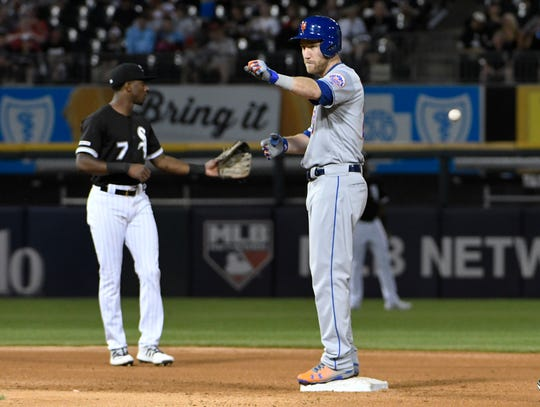 Todd Frazier #21 of the New York Mets gestures after hitting a double against the Chicago White Sox during the fifth inning at Guaranteed Rate Field on July 31, 2019 in Chicago, Illinois.