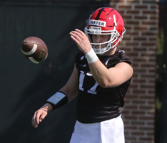 McLane Carter working out with his fellow quarterbacks during Rutgers football practice this morning at their facility in Piscataway on August 1.