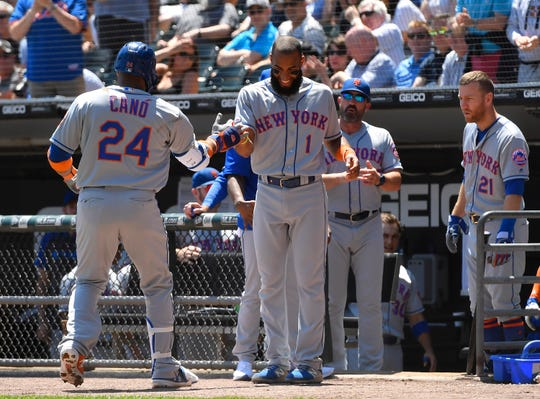 New York Mets shortstop Amed Rosario (1) celebrates with New York Mets second baseman Robinson Cano (24) for his solo home run in the second inning against the Chicago White Sox at Guaranteed Rate Field.