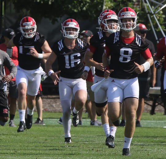 Rutgers quarterbacks, left to right, McLane Carter,  Cole Snyder, Johnny Langan, Austin Albericci and Artur Sitkowski jog to loosen up as they get ready for Rutgers football practice this morning at their facility in Piscataway on August 1, 2019.