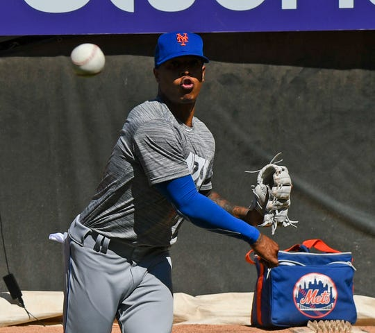 New York Mets pitcher Marcus Stroman warms up in the bullpen before a game against the Chicago White Sox Wednesday, July 31, 2019, in Chicago.