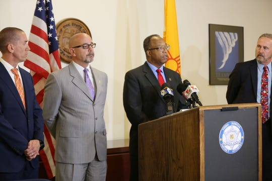 Chief Deputy District Attorney Gerald Byers, reads off charges against inmates who attacked Southern New Mexico Correctional Facility prison guards July 16, during a news conference Thursday Aug. 1, 2019. From left: New Mexico State Police Captain Randy Larcher, SNMCF Warden Daniel Peters, Byers and District Attorney Mark D'Antonio.