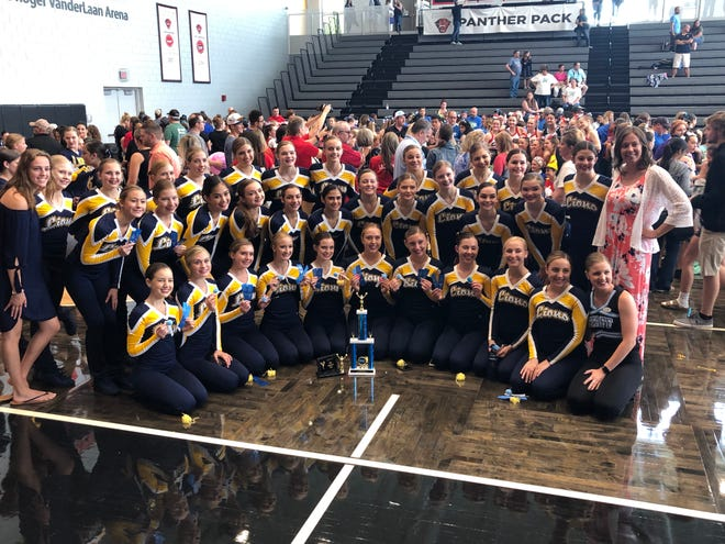 The South Lyon varsity pom team poses with their medals.