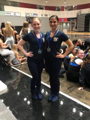 Leah Evangelista and Emma Reif won the varsity and JV toe touch competition in Grand Rapids.