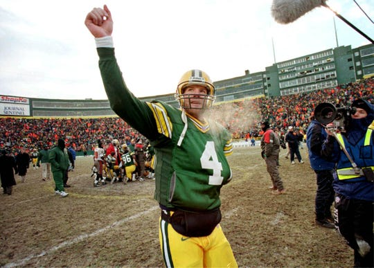 2000 SEASON: Green Bay quarterback Brett Favre walks off the field Dec. 24, 2000, after the Packers beat the Tampa Bay Buccaneers 17-14 in overtime in the last game before renovations begin at Lambeau Field.