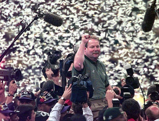 Green Bay Packers head coach Mike Holmgren is carried off the field after his team won Super Bowl XXXI 35-21 against the New England Patriots in New Orleans on Jan. 26, 1997.