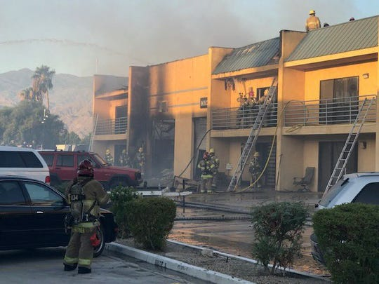 Firefighters put out a three-alarm fire at a business complex off Joni Drive in Palm Desert Thursday morning.