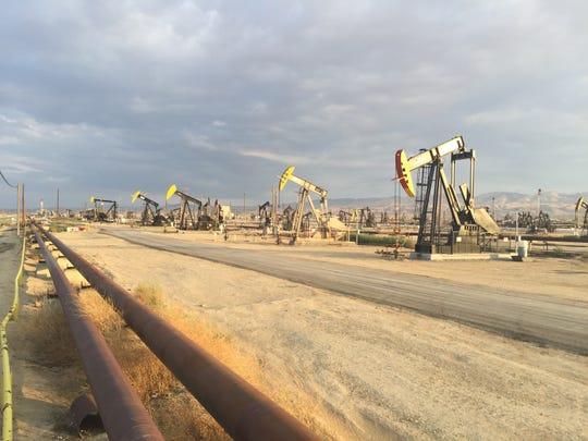 Belridge oil field pipes and jacks, Kern County, CA