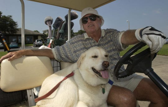 Longtime Pensacola Sports Association executive director Jerry Stephens, with his dog J.J., in a 2003 photo. Stephens passed away Thursday, Aug. 1, 2019.